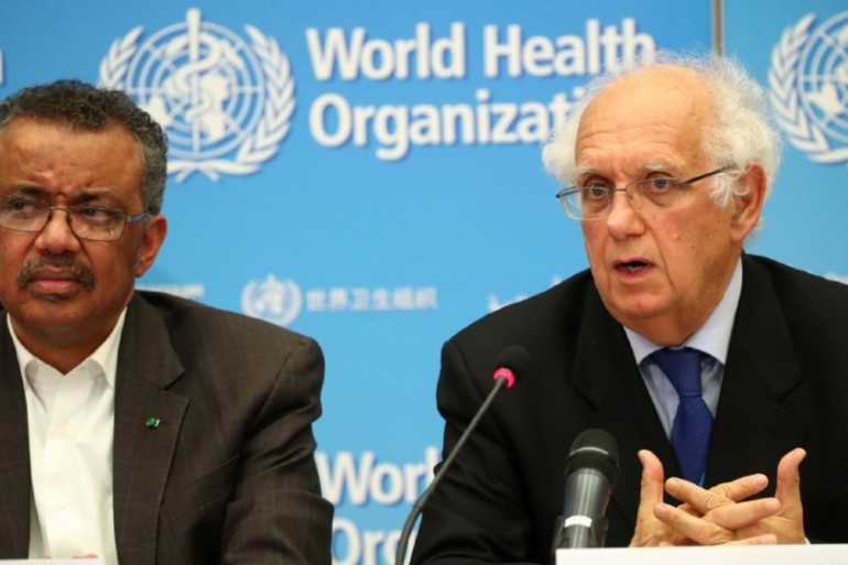 WHO Director-General Tedros Adhanom Ghebreyesus, left, called for 'solidarity, not stigma', while WHO Emergency Committee chair Didier Houssin called on nations to reconsider travel bans [Denis Balibouse/Reuters]