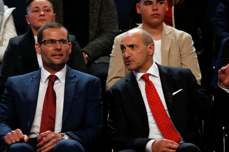 Abela, left, was chosen as the head of Malta's Labour party, replacing scandal-plagued Muscat who is stepping down [Darrin Zammit Lupi/Reuters]