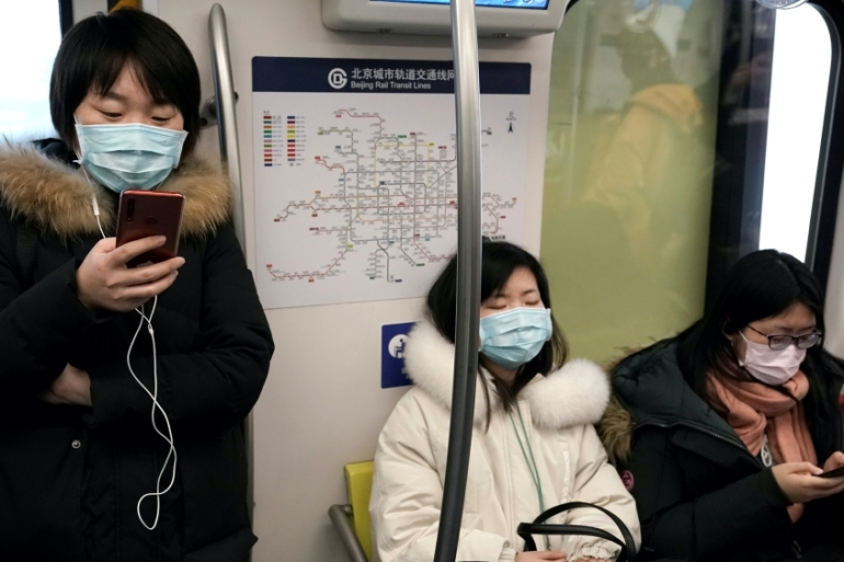 People across the Asia Pacific region, like these commuters in Beijing, are starting to take precautions against a new virus that originated in central China [Jason Lee/Reuters]
