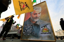 A picture of the Iranian General Qassem Soleimani is seen at the funeral of the Iraqi militia commander Abu Mahdi al-Muhandis who was killed with him in Baghdad on January 3 [Reuters/Thaier al-Sudani]