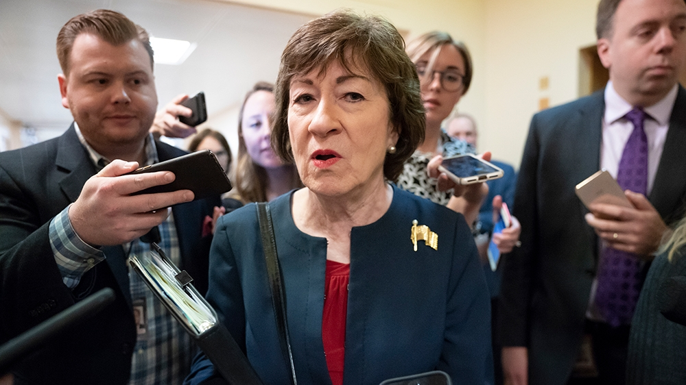 Sen. Susan Collins, R-Maine, is surrounded by reporters as she rushes to a vote at the Capitol in Washington, Wednesday, Nov. 6, 2019. (AP Photo/J. Scott Applewhite)