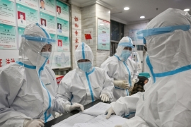 The WHO team is expected to visit Wuhan where the coronavirus first emerged late in 2019 [File: Hector Retamal/AFP]