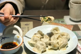 Families come together during the Lunar New Year, and pork and chive dumplings are at the top of the menu [Simina Mistreanu/Al Jazeera]