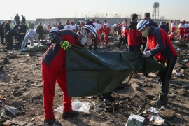 Red Crescent workers check plastic bags at the site where the Ukraine International Airlines plane crashed on the outskirts of Tehran, Iran [Reuters]