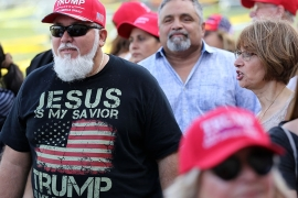 Jorge Alfonso, 56, of Miami waits in line outside the King Jesus International Ministry Church where President Trump held a rally for evangelical supporters [Lynne Sladky/AP Photo]