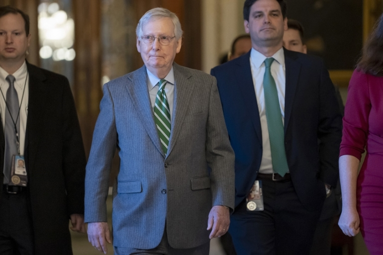 Senate Majority Leader Mitch McConnell leaves the Senate chamber at the Capitol in Washington, DC [J Scott Applewhite/AP Photo]