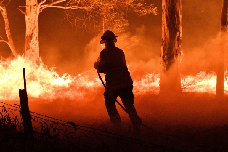 Australia should expect a longer and more extreme bushfire season as carbon emissions create a hotter, drier climate, a government agency warned on Friday [File: Saeed Khan/AFP]