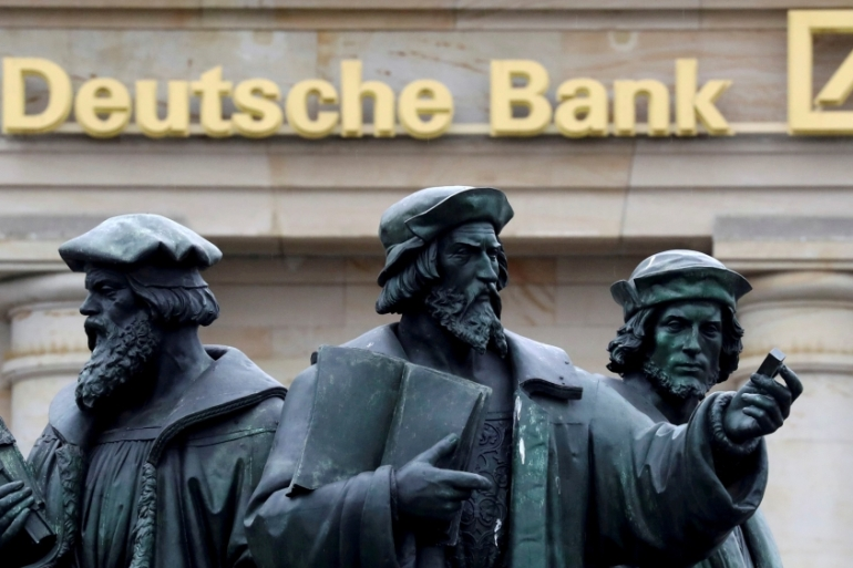 Deutsche Bank is halving 2019 bonuses for individual board members and delaying employee salary raises by a few months as part of its cost reductions [File: Kai Pfaffenbach/Reuters]