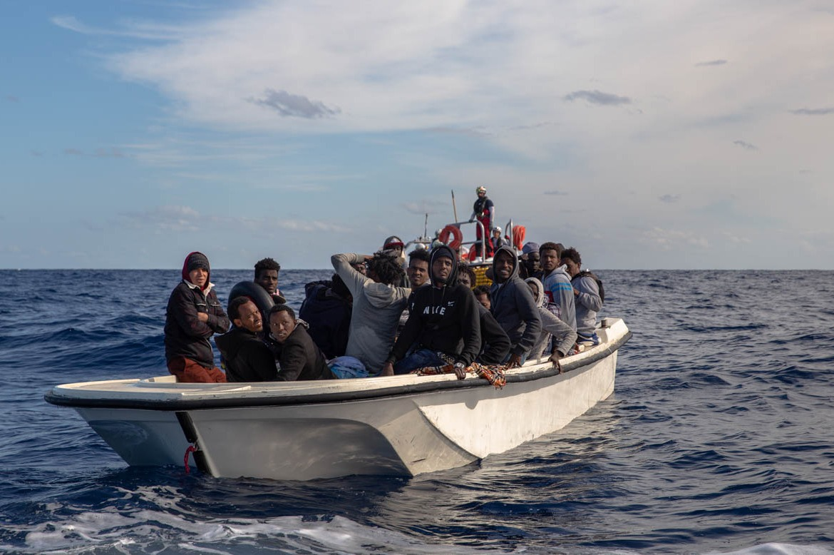"People are told to board the boats in the middle of the night. ""You can't see anything. It's dark and scary. But you know you'll die in Libya if you don't leave,"" Saruna, 17, said. ""You call home before you leave. You don't know if you'll survive at sea. You just pray to God and go."" [Faras Ghani/Al Jazeera]"