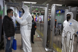 The coronavirus outbreak claimed its first victim in Beijing, according to authorities [Mark Schiefelbein/AP]