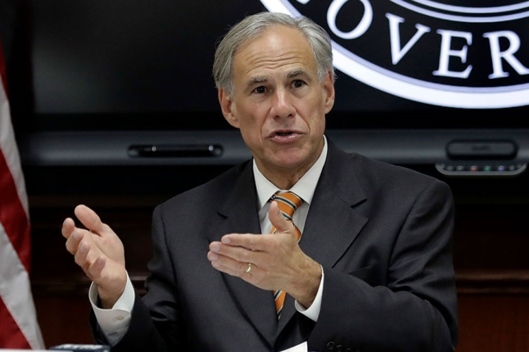 'It is now time to open Texas 100 percent,' the state's Governor Greg Abbott said at a Tuesday news briefing [File: Eric Gay/AP Photo]