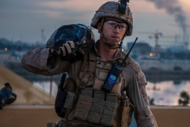 A a US Marine who is part of a quick reaction force, carries a sand bag during the reinforcement of the US embassy compound in Baghdad, Iraq [File: Handout/US Marine Corps/Kyle C Talbot/AP Photo]