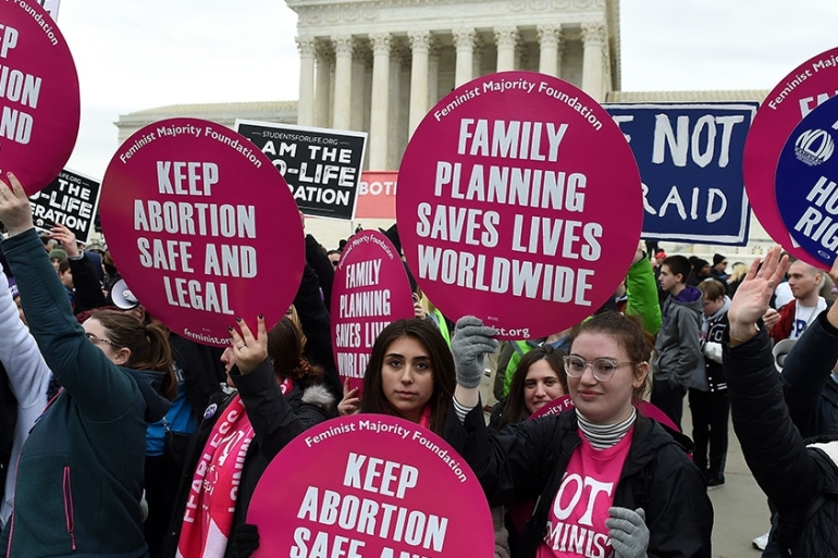 Pro- and anti-abortion rights activists demonstrate in front of the the US Supreme Court during the 47th annual March for Life [File: Oliver Douliery/AFP]