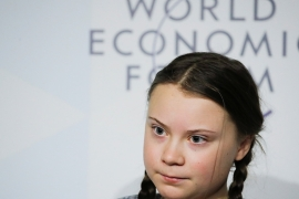 As bushfires continue in Australia and the Earth notches record high temperatures, 17-year old climate activist Greta Thunberg along with hundreds of campaigners will head to Klosters, Switzerland over the weekend to demand world leaders and those in power take action on climate [File: Arnd Wiegmann/Reuters]