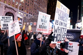 People gather for a protest against the Trump administration's escalation of military tensions with Iran in Times Square in New York [File: Justin Lane/EPA]