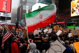 People take part in an anti-war protest amid increased tensions between the US and Iran at Times Square in New York City [Eduardo Munoz/Reuters]