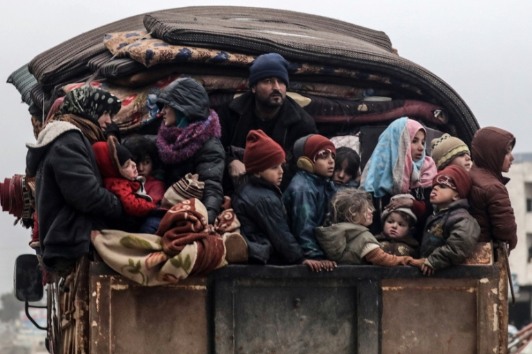 The 900,000 people fleeing fighting represent the largest exodus of civilians since World War II [Khalil Ashawi/Reuters]