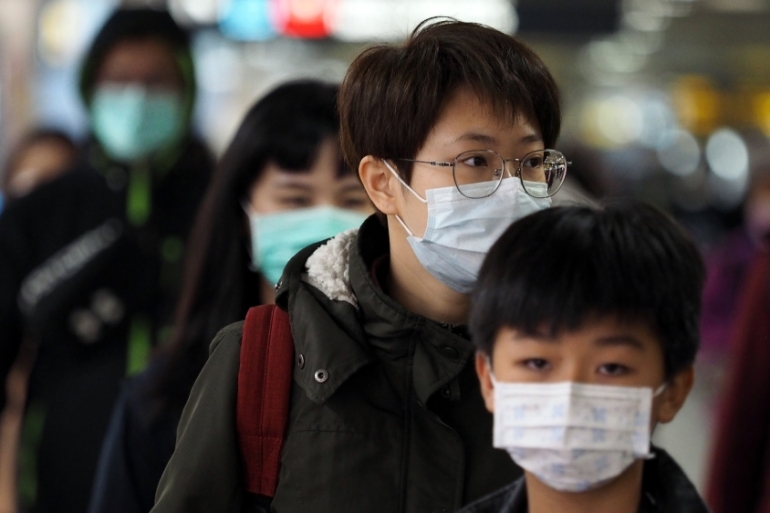 Countries are tightening restrictions on travellers from China as the death toll from the coronavirus outbreak mounts. [David Chang/EPA]