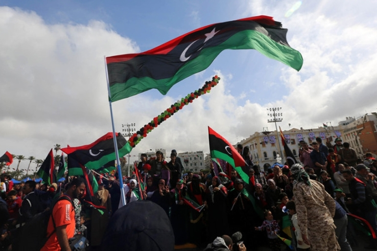Libyans in Martyrs' Square, Tripoli celebrate the anniversary of the uprising that ended the rule of Muammar Gaddafi [File: EPA]