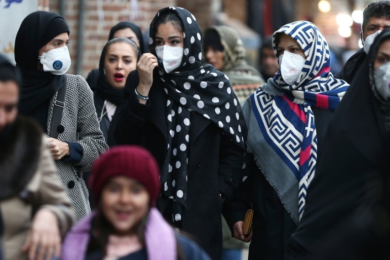 As four people died due to coronavirus in Iran, people walking in Tehran's Grand Bazaar wear protective masks to prevent contracting the virus [Nazanin Tabatabaee/WANA via Reuters]