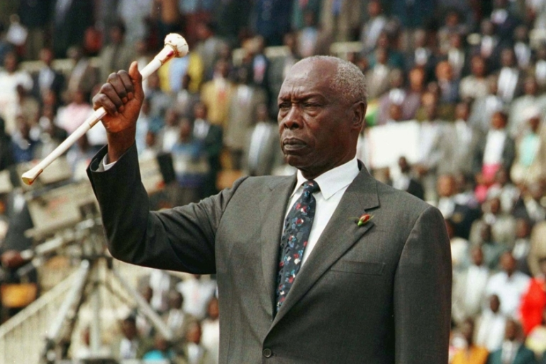 President Daniel arap Moi raises his baton to salute Kenyans during the 34th independence day celebrations in Nairobi, Kenya on December 12, 1997 [File: Reuters/George Mulala]