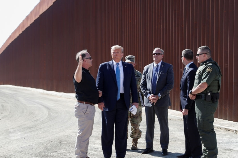 US President Donald Trump visiting a section of the US-Mexico border wall in Otay Mesa, California, US [File: Tom Brenner/Reuters]