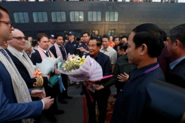 Hun Sen welcomes passengers and crews of MS Westerdam, a cruise ship that spent two weeks at sea after being turned away by several countries over fears that someone on board might have the coronavirus [Soe Zeya Tun/ Reuters]