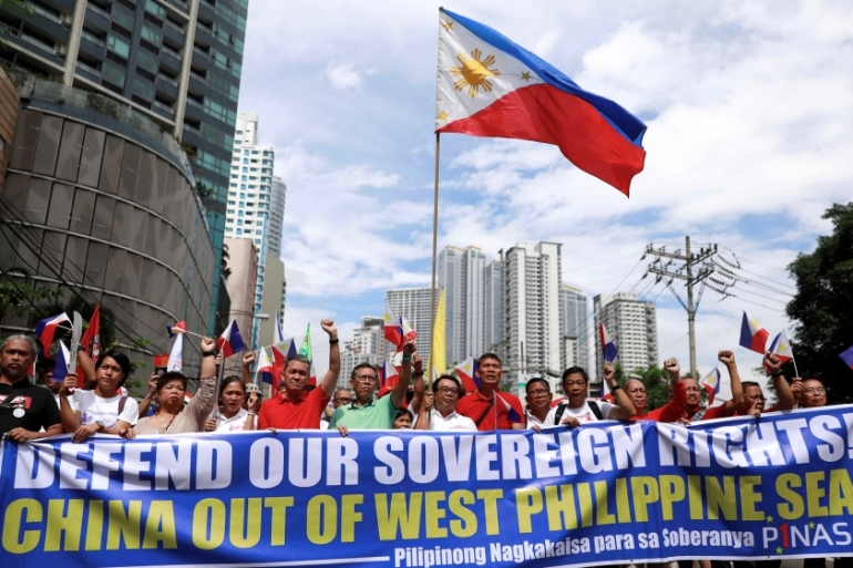 Filipino activists protest against the presence of Chinese vessels in the South China Sea at the Chinese embassy in Makati City, the Philippines on April 9, 2019 [File: Reuters/Eloisa Lopez]