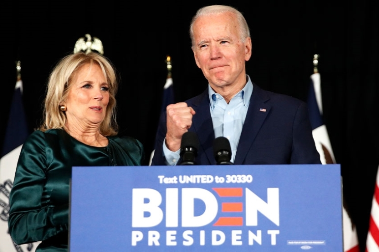 Democratic presidential candidate former Vice President Joe Biden and wife Jill Biden at a campaign rally in Des Moines, Iowa [File: John Locher/AP Photo]