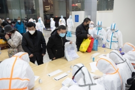 Patients infected by the coronavirus are received at a makeshift hospital at Wuhan International Convention and Exhibition Center in Wuhan on Wednesday [YFC China Out via EPA]