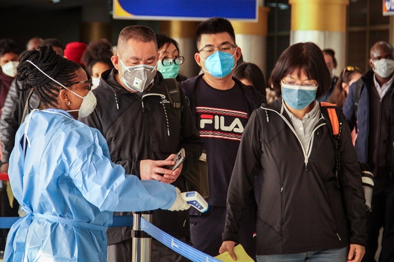 Passengers arriving from Changsha in China are screened for the new type of coronavirus [Patrick Ngugi/ AP]