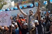Supporters of the AAP celebrate at the party headquarters in New Delhi on February 11, 2020 [Reuters/Anushree Fadnavis]
