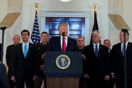 US President Donald Trump delivers a statement about Iran flanked by US Defense Secretary Mark Esper, Army Chief of Staff General James McConville, Chairrman of the Joint Chiefs of Staff Army General Mark Milley, Vice President Mike Pence and Secretary of State Mike Pompeo on January 8, 2020. [File: Kevin Lamarque/Reuters]