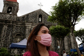 The news of the first coronavirus death outside China came as Filipinos headed to Sunday mass [Aaron Favila/AP Photo]