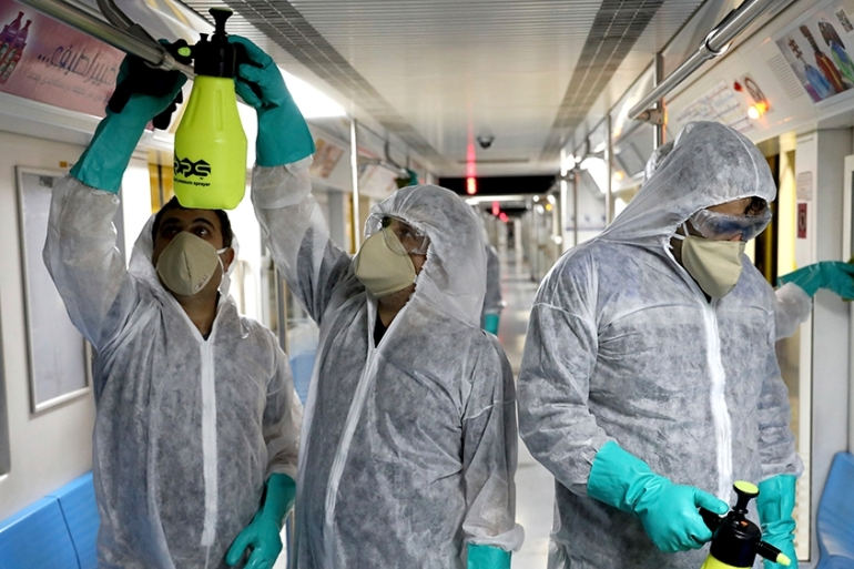 Workers disinfect subway trains against coronavirus in Tehran, Iran, in the early morning of Wednesday [Ebrahim Noroozi/AP Photo]