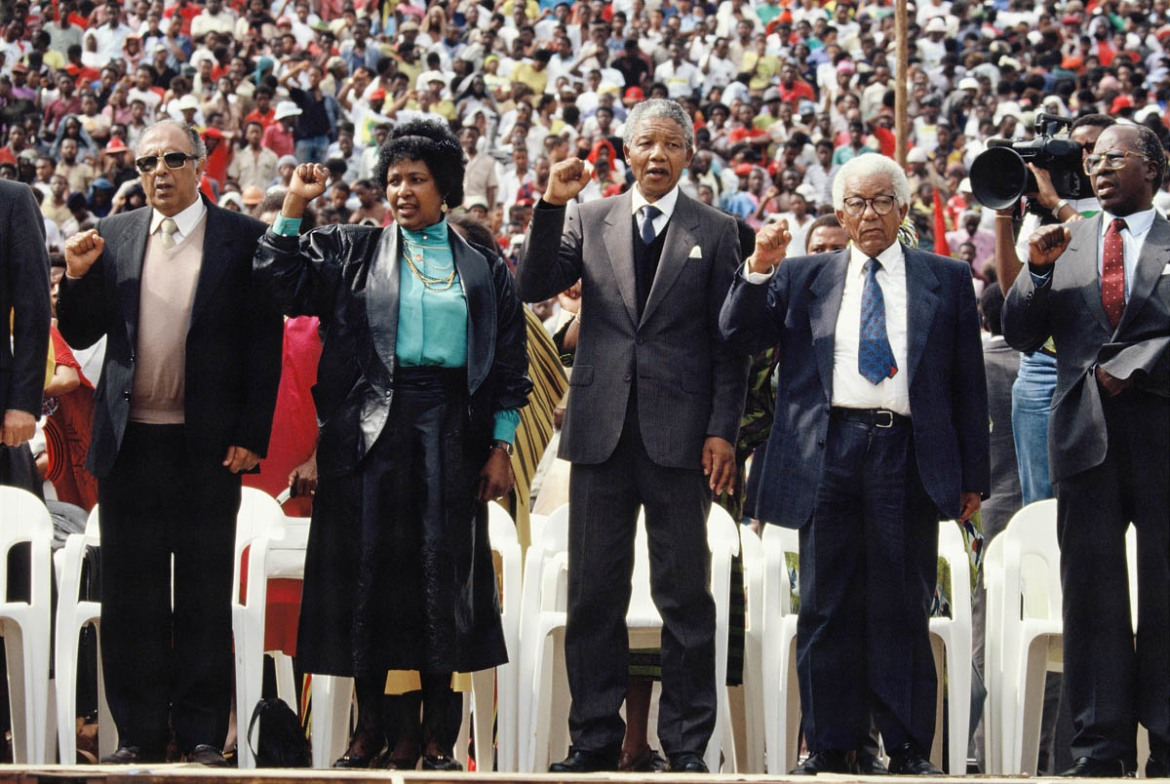 Winnie Mandela, African National Congress (ANC) leader Nelson Mandela and General Secretary Walter Sisulu attend a rally in Soweto. [Georges De Keerle/Getty Images]