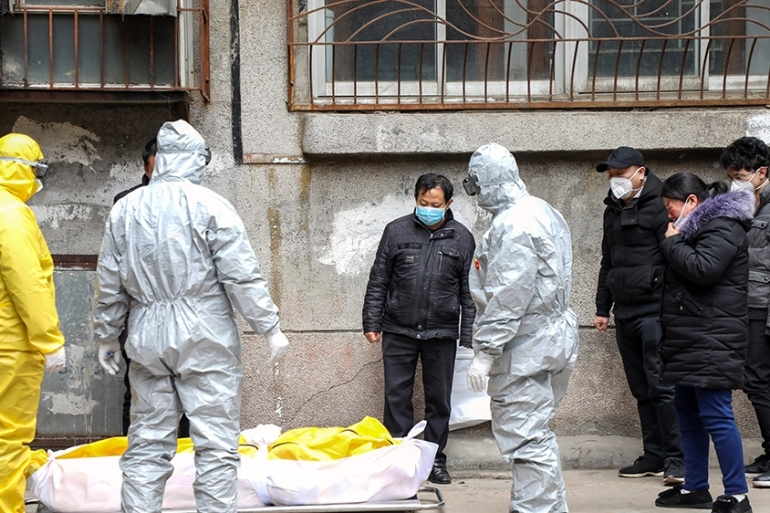 China's health commission has ordered swift cremations and no funerals for the coronavirus dead [Yuan Zheng/EPA]