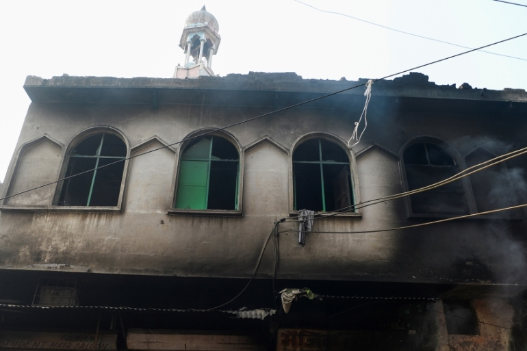In all, 11 mosques, five madrasas or religious schools, a Muslim shrine and a graveyard were attacked and damaged, a fact-finding team from the commission said [Profile: Sajjad Hussain/AFP]
