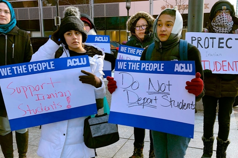 Protesters standing outside the federal court where a hearing was scheduled for Iranian Northeastern University student Shahab Dehghani in Boston [Philip Marcelo/AP Photo]