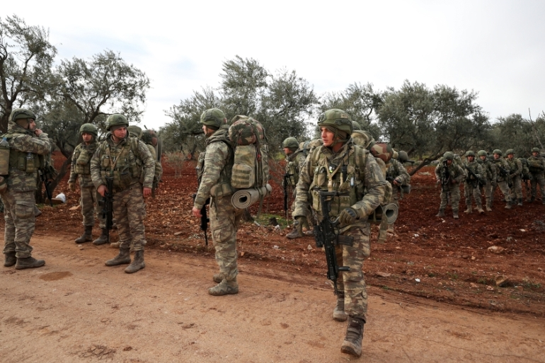 Turkish soldiers gather in the village of Qaminas, about six kilometres southeast of Idlib city in northwestern Syria [Omar Haj kadour/AFP]