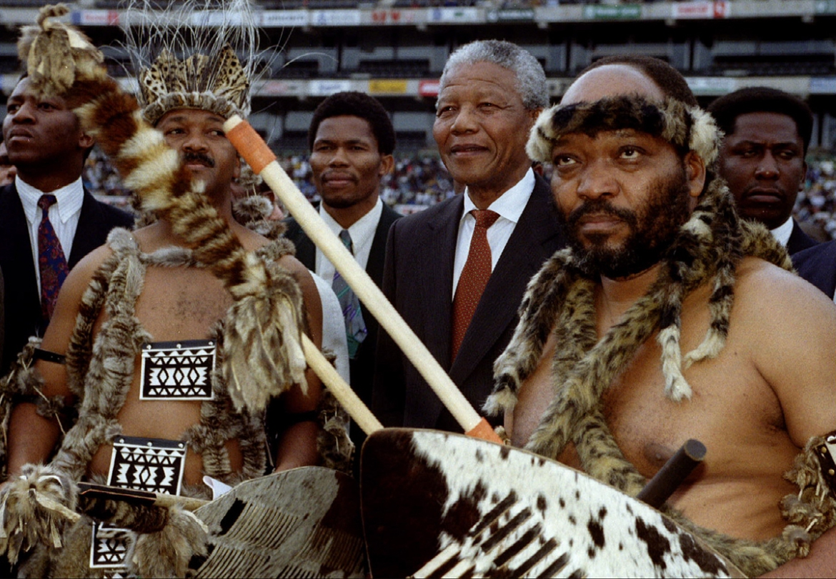 Nelson Mandela arrives at a Sonke Festival campaign rally for the April 1994 presidential elections. Having guided the country through a dramatic transition that marked the end of apartheid, Mandela in 1994 became South Africa's first black president. [Juda Ngwenya/Reuters]