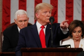 US President Donald Trump delivers his State of the Union on the eve of his expected impeachment acquittal. [Leah Millis/Reuters]