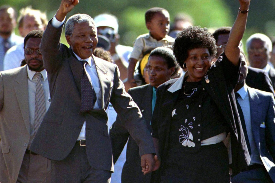 Mandela is accompanied by his then-wife Winnie, moments after his release from prison. [Reuters]