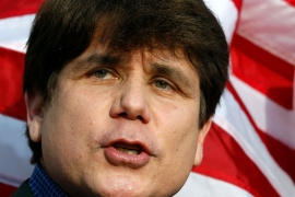 Former Illinois Governor Rod Blagojevich makes a statement to reporters outside his Chicago home one day before reporting to federal prison in Colorado to serve a 14-year sentence for corruption [File: Jeff Haynes/AP Photo]