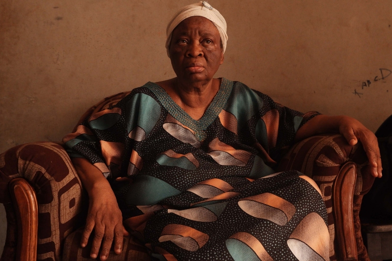 Elizabeth Mustafa in the home she shares with her son and his family in Ibadan [Ayobami Ogungbe/Al Jazeera]