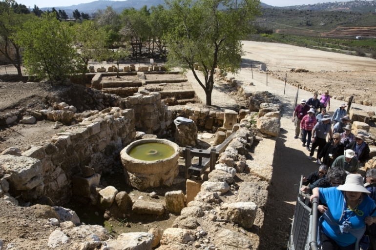 Tourists visit the archaeological site of Tel Shiloh in the West Bank, March 12, 2019 [File: AP Photo/Sebastian Scheiner]