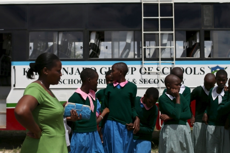 Students arrive at the start of a social event advocating against harmful practices such as female genital mutilation at the Imbirikani Girls High School in Imbirikani, Kenya [File: Siegfried Modola/Reuters]