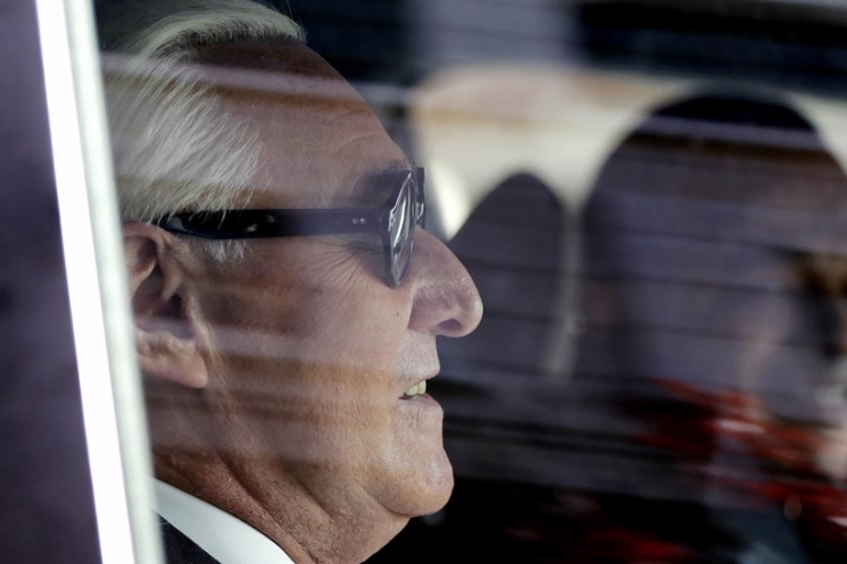 Roger Stone sits in a vehicle while leaving federal court Washington, DC after being found guilty at his trial in in federal court. [File: Julio Cortez/AP Photo]