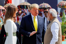 Trump and first lady Melania Trump talk to Indian Prime Minister Narendra Modi after arriving at Sardar Vallabhbhai Patel International airport in Ahmedabad [Al Drago/Reuters]