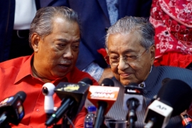 Muhyiddin Yassin, left, is a former interior minister and president of the Mahathir Mohamad's Bersatu party [File: Lai Seng Sin/Reuters]